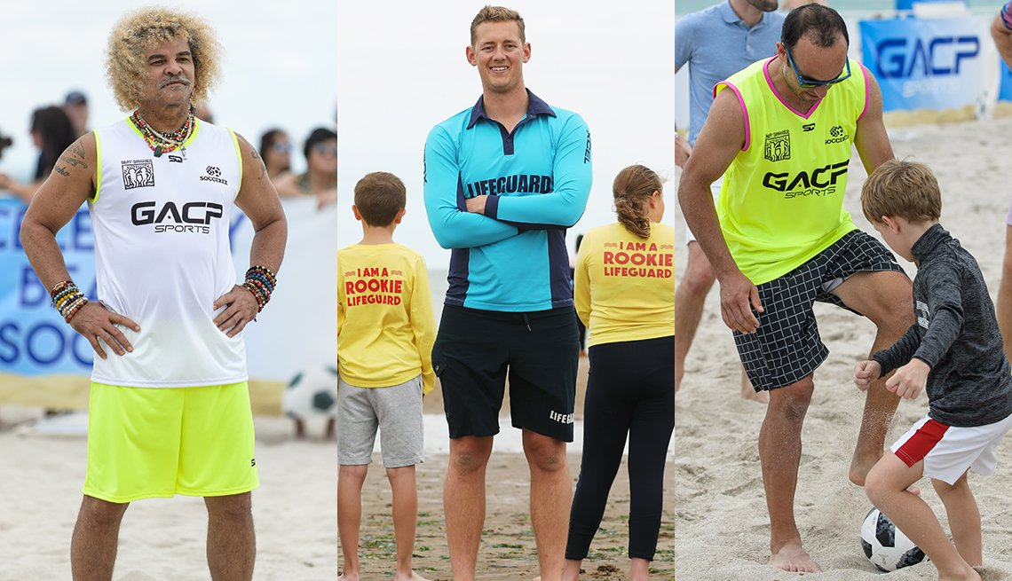 item 9, Gallery image. Carlos 'El Pipe' Valderrama; Aussie Trent Maxi Maxwell in neon blue color block rashguard and navy cargo-style trunks; Landon Donovan in neon tank and black check shorts