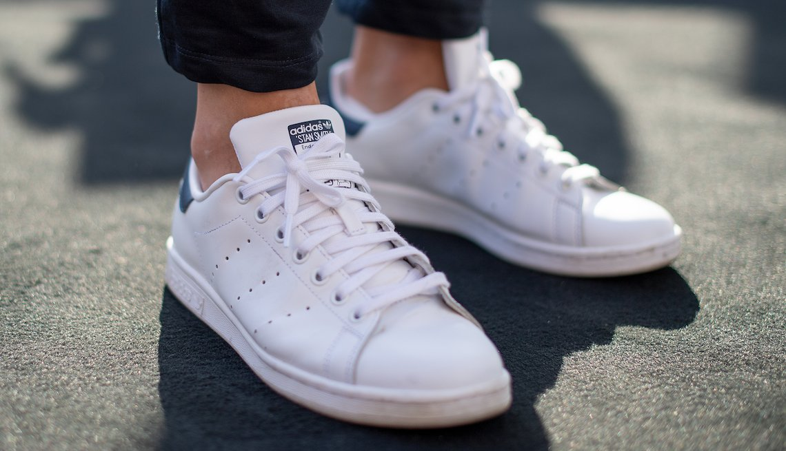 A pair of white Adidas Stan Smith sneakers