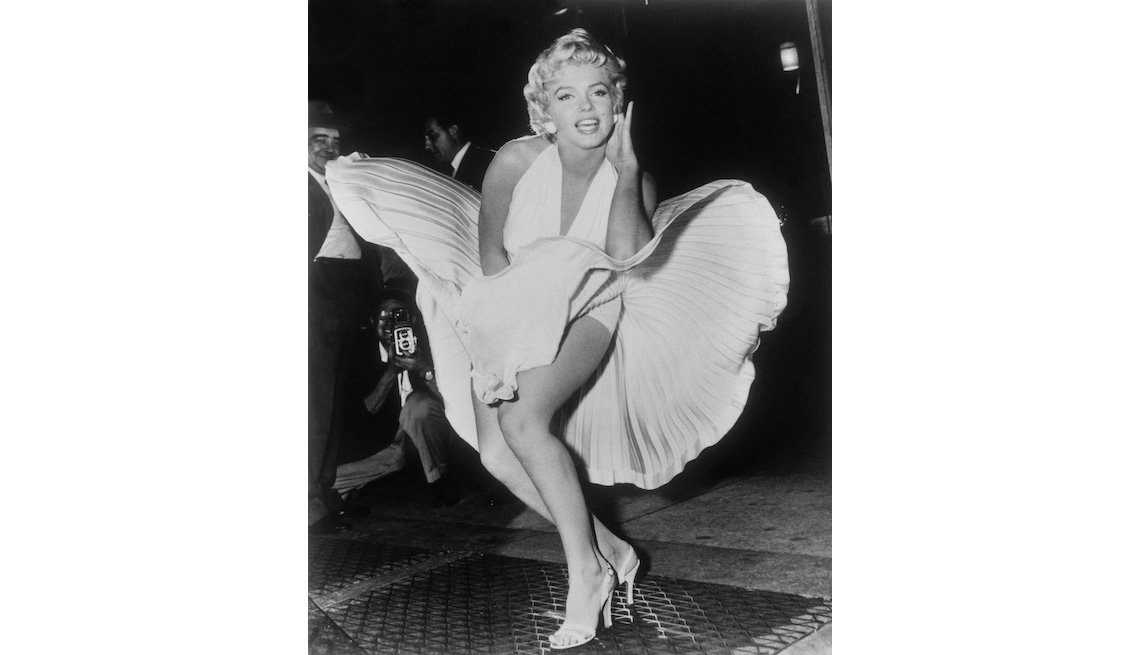 "item 9, Gallery image. Marilyn Monroe poses over the updraft of a New York subway grating while in character for the filming of ""The Seven Year Itch"" in Manhattan on September 9, 1954."