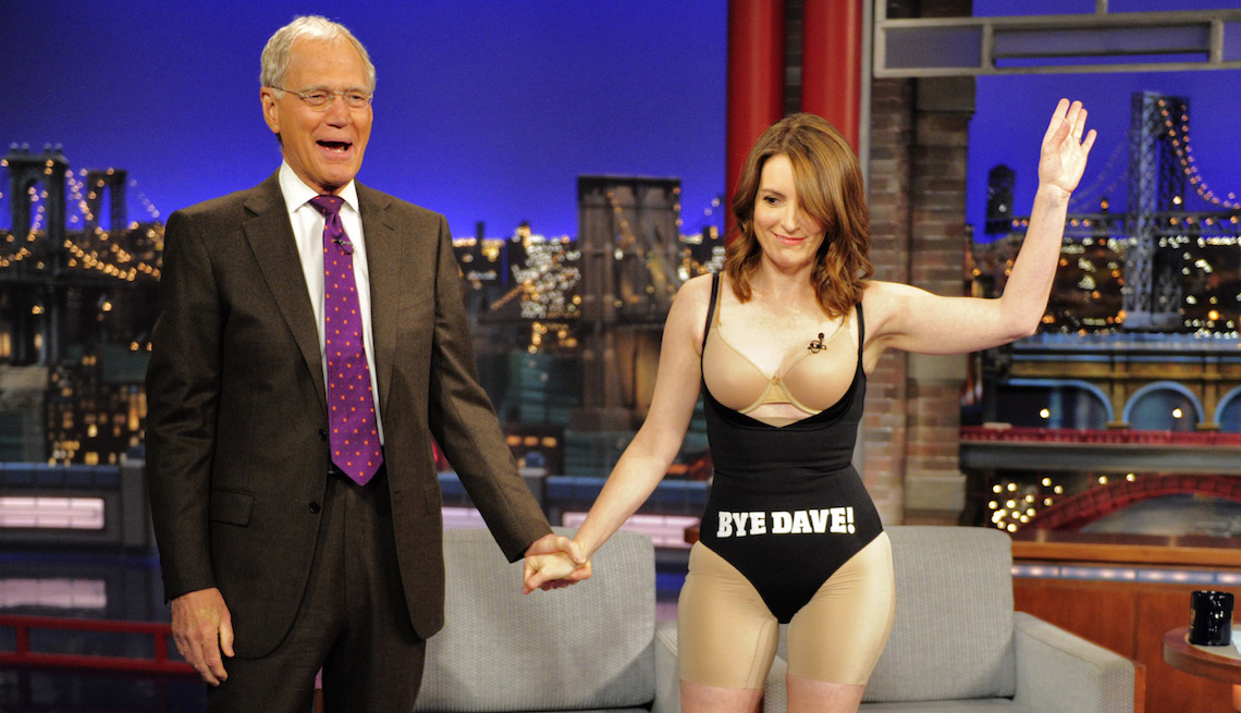 item 1 of Gallery image - Tina Fey takes off her dress after her last appearance on the CBS Late Show with David Letterman, Thursday May 7, 2015.
