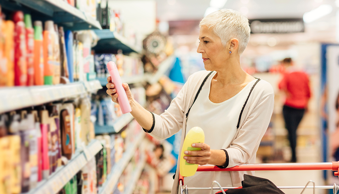 item 3 of Gallery image - A woman looking at different beauty products in a supermarket