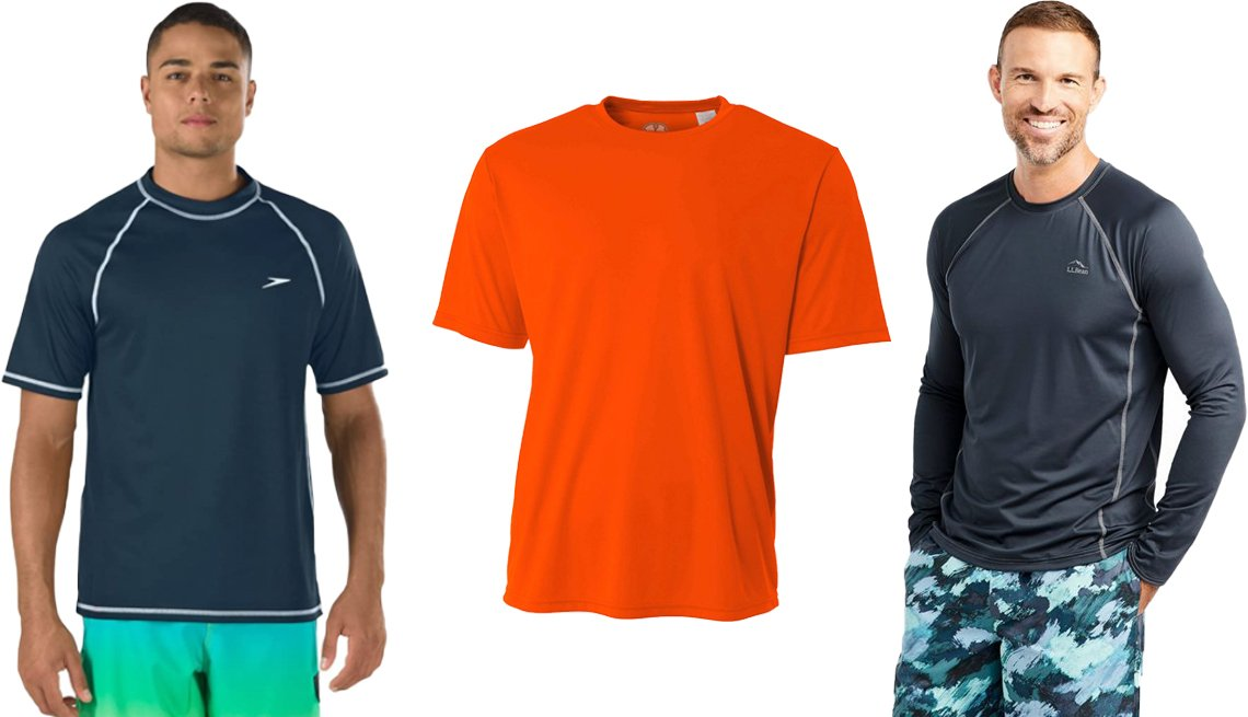 item 10, Gallery image. (Left to right) Speedo Men's UV Swim Shirt in New Navy; Hardcore Water Sports Men's Rash Guard Shirt SPF in Safety Orange; L.L. Bean Men's Swift River Cooling Rash Guard in Carbon Navy