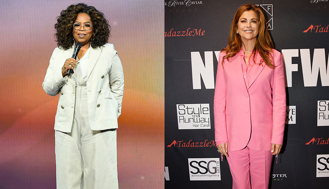 item 3 of Gallery image - Oprah Winfrey in a white pantsuit and Kathy Ireland in a pink pantsuit