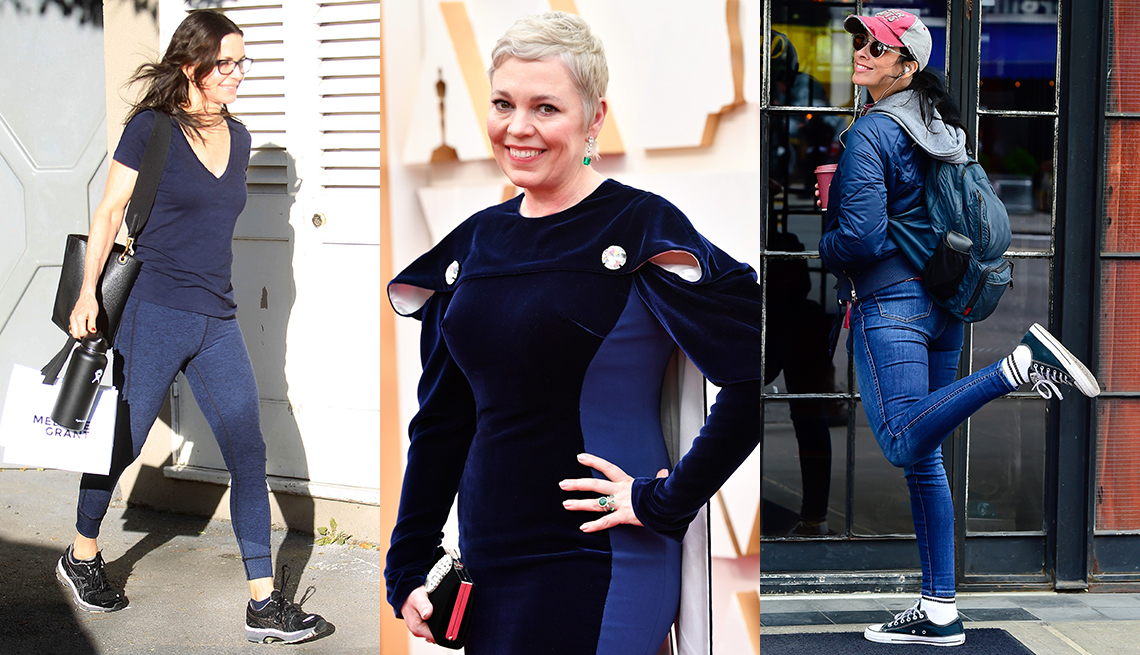 item 1 of Gallery image - Courteney Cox walking on the sidewalk in a blue shirt and blue workout pants Olivia Colman wearing a navy blue dress at the Academy Awards and Sarah Silverman wearing a blue jacket and blue jeans
