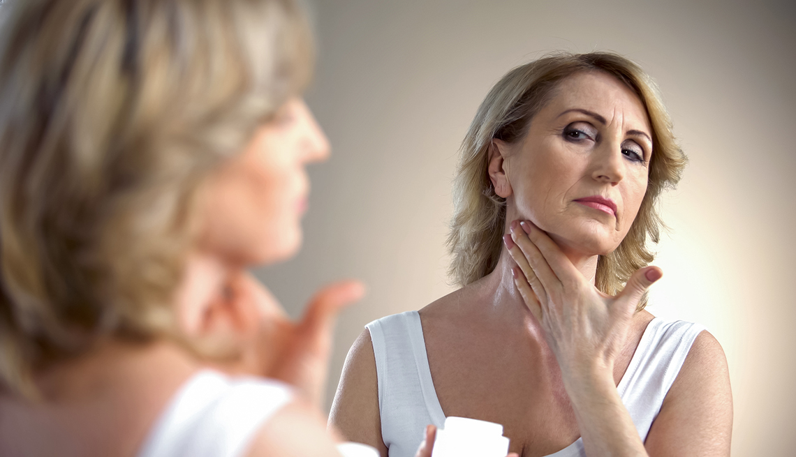 item 10 of Gallery image - A woman applying cream on her neck