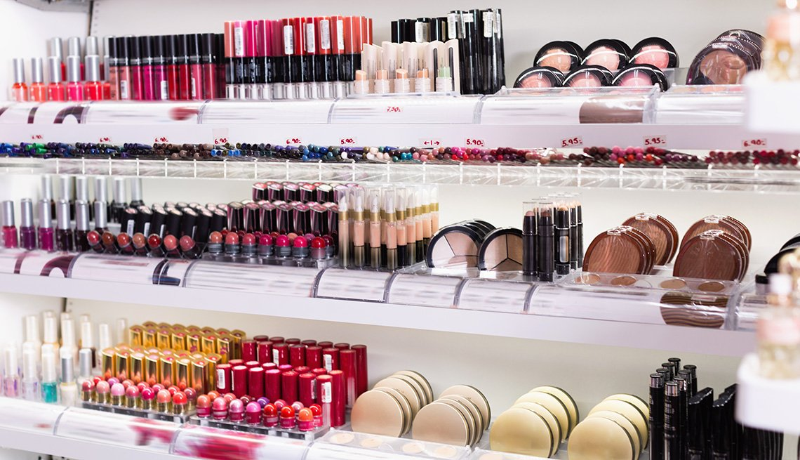 An assortment of makeup products on display in a cosmetics store