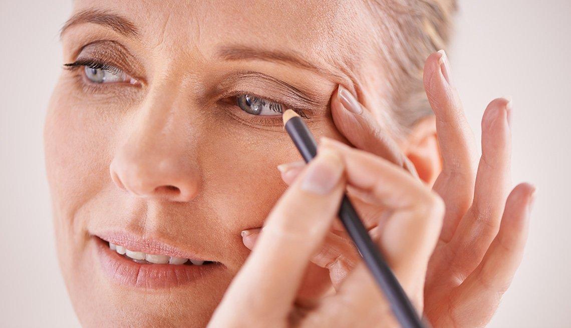 item 4 of Gallery image - A woman applying eyeliner