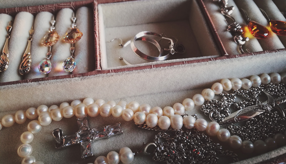 Earrings, necklaces and other jewelry in box