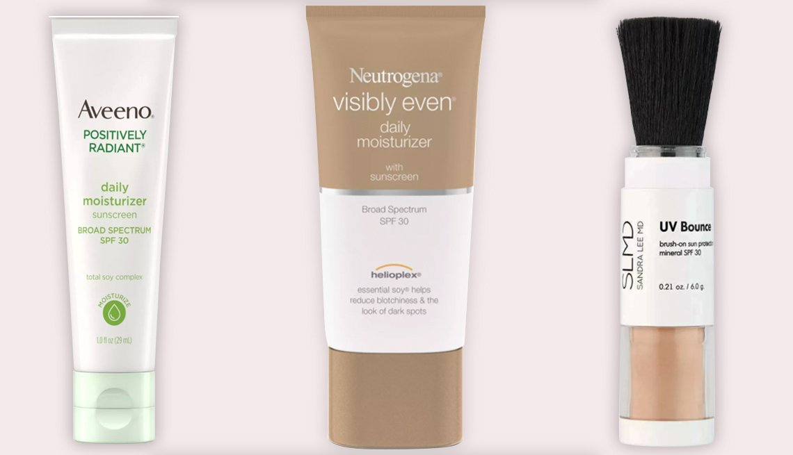 item 1 of Gallery image - (De izquierda a derecha) Aveeno Positively Radiant Daily Moisturizer with Soy SPF 30; Neutrogena Visibly Even Daily Facial Moisturizer SPF 30; SLMD Skincare UV Bounce SPF 30 en tono 002.