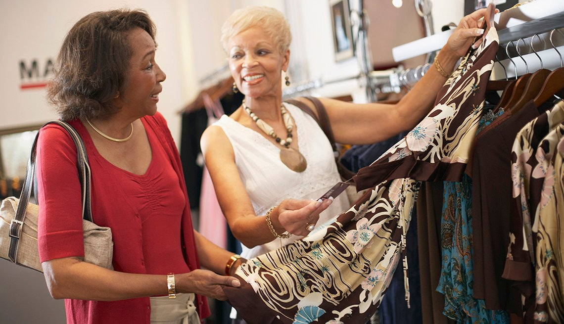 Two women looking at a dress at a store