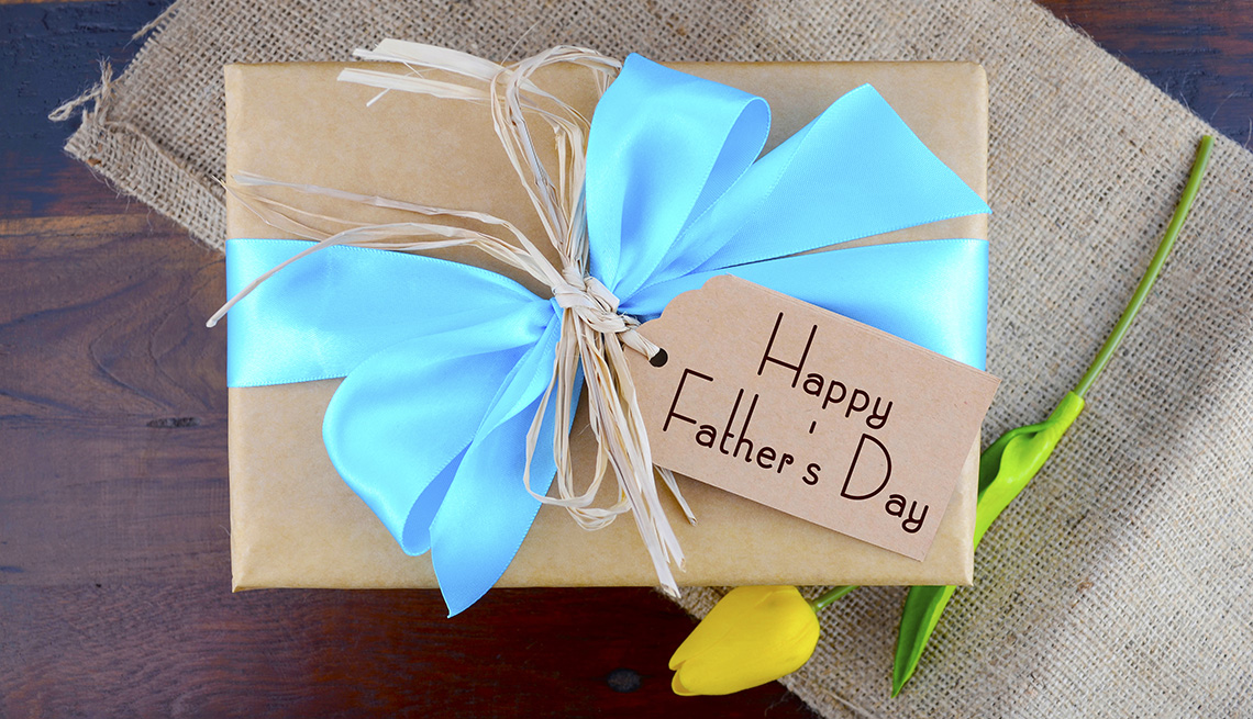 A Father's Day gift wrapped with a blue ribbon