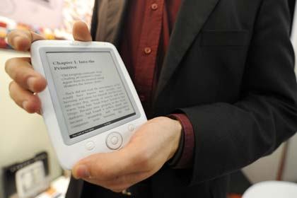 Man Holding an Electronic Reader
