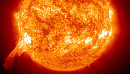 An eruptive prominence: a massive solar eruption is shown being blasted away from the Sun.