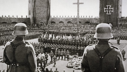 Adolf Hitler (lower center, walking) at the state funeral for former German President Paul von Hindenburg, five days after declaring himself Fuhrer.