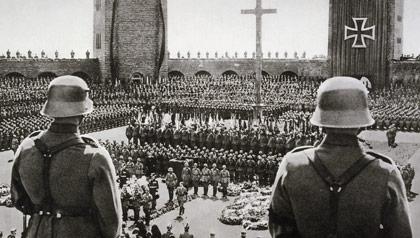 Adolf Hitler (lower center, walking) at the state funeral for former German President Paul von Hindenburg, five days after declaring himself Fuhrer.