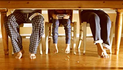 Father and children's feet at kitchen table-New Arrivals Book