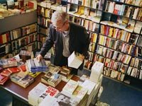 Man searching through books at a bookstore
