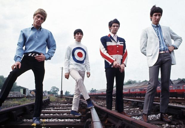 British band members of The Who with lead singer Roger Daltrey, drummer Keith Moon, bass player John Entwistle and guitarist Pete Townshend - Pete Townshend Retrospective