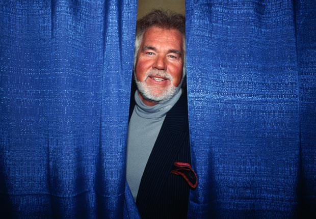 Musician Kenny Rogers looks out from backstage during events celebrating the inauguration of President Bill Clinton - Kenny Rogers Retrospective