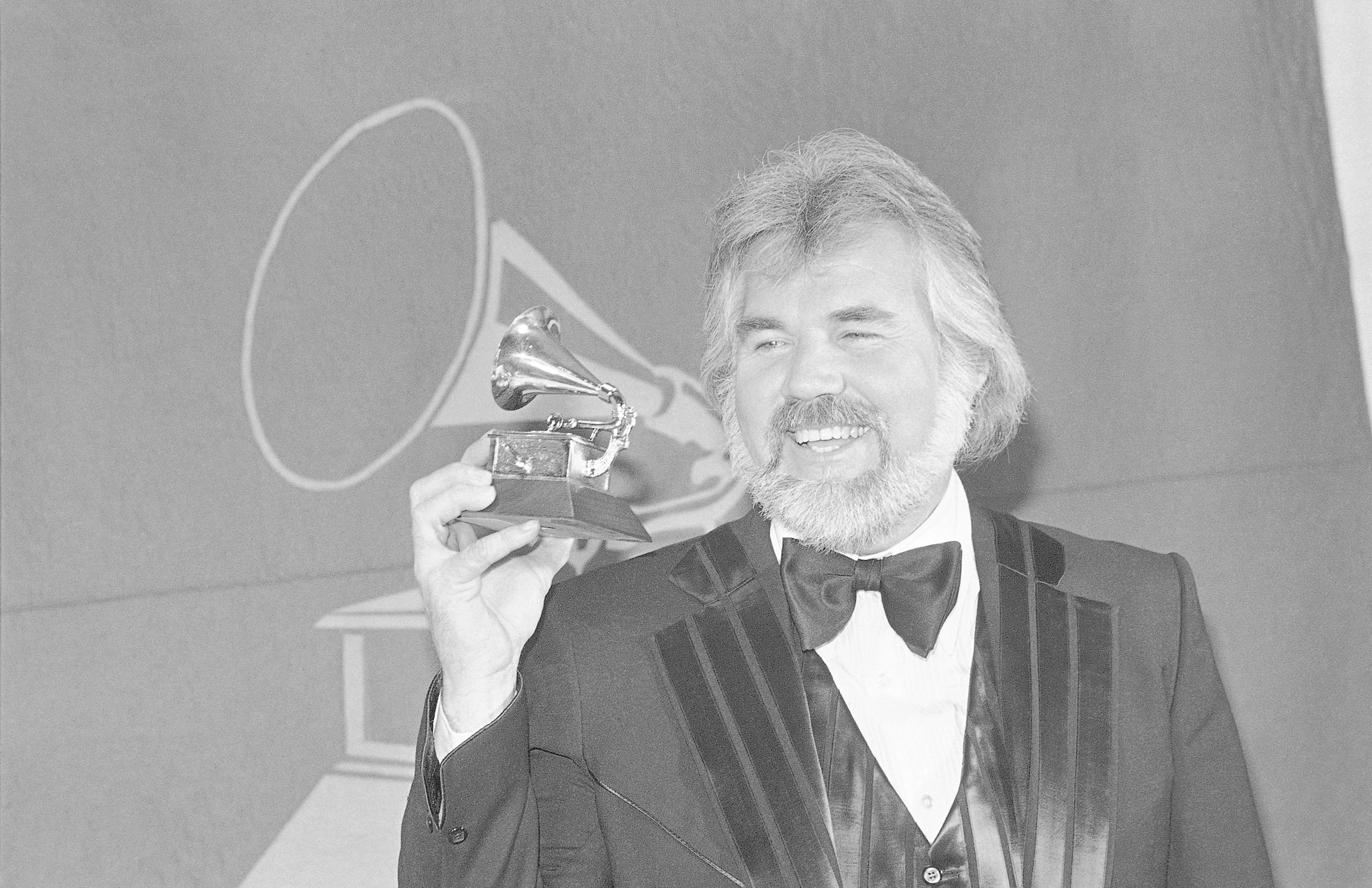 Entertainer Kenny Rogers holds Grammy Award he received in Los Angeles in 1980 for best country male performance for his hit THE GAMBLER - Kenny Rogers Retrospective