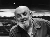 Ansel Adams in front of his famous photograph, 'Moonrise, Hernandez' at home in Carmel, California.