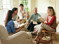 Women laughing in book club
