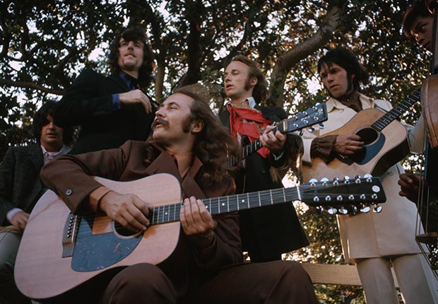 Folk-rockers Crosby, Stills, Nash, and Young stand in a field for a portrait in August 1969
