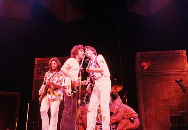 Neil Young (right) sings and plays guitar with members of Crazy Horse on Young's Rust Never Sleeps concert tour Los Angeles, California,  in ca. 1978
