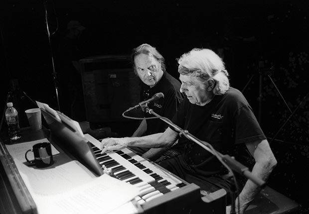 Neil Young sits at a Piano with Ben Keith at the Fox Theatre in Redwood City, California in October 2007