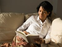 Woman reading on the couch, Don't Miss These Books in 2012