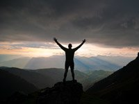 Brene Brown taking risks daring mountain nature silhouette