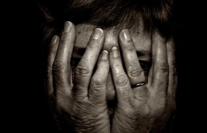 survival peek look hands trough fingers female woman women senior mature black white sepia aged care careworn shy alone loss