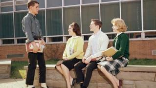 Teens in front of high school in 1963. (ClassicStock/Alamy)
