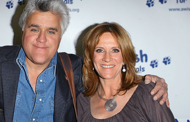 """Jay Leno with comedian & writer Carol Leifer attend the """"A Wish for Animals"""" stand-up comedy night at the Laugh Factory in West Hollywood, California."""