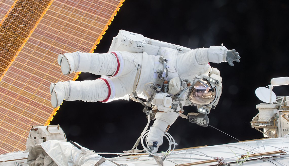 Scott Kelly makes an unplanned spacewalk to free a jammed device on the space station.