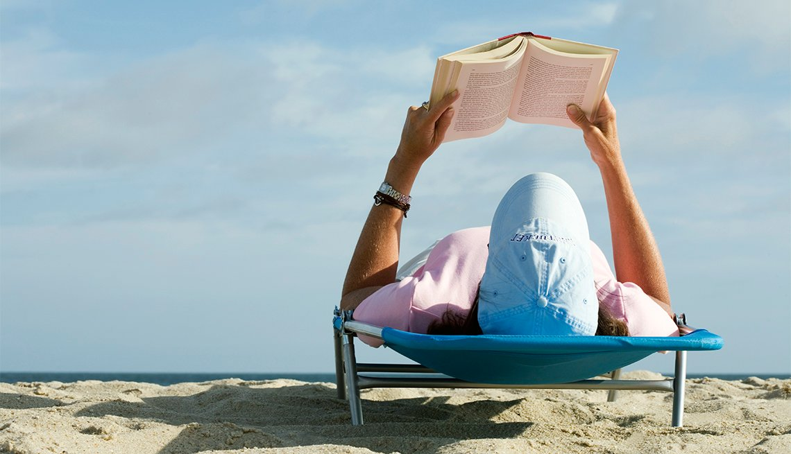 Woman Reading On Beach