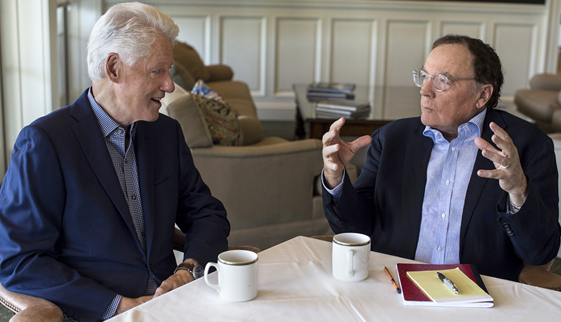 Bill Clinton and James Patterson sitting at a table.