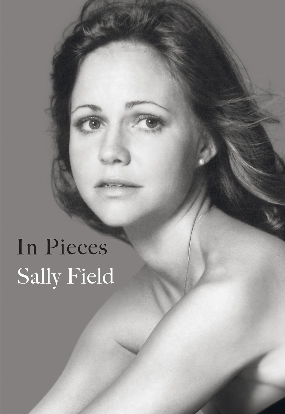 "Book cover of Sally Field and text that reads ""In Pieces, Sally Field"""