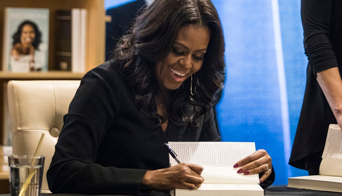 Michelle Obama signing a book