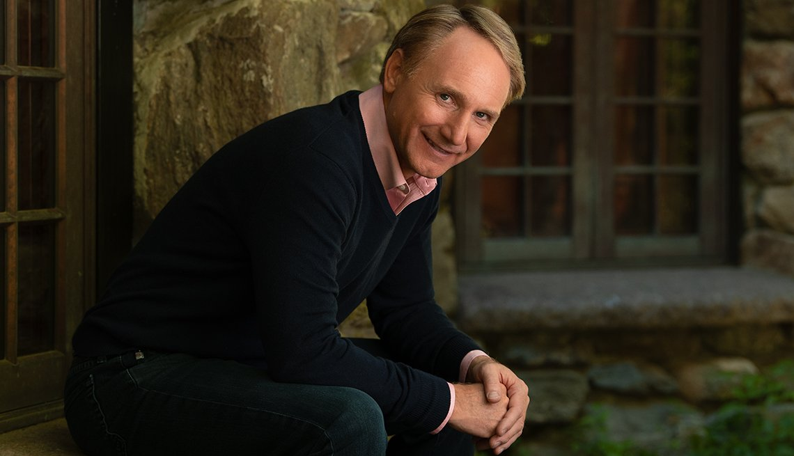 Dan Brown poses for a photo