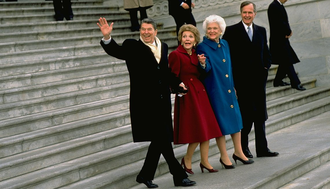 President Ronald Reagan and wife Nancy (R) walking down steps, hand-in-hand, accompanied by President George H. W. Bush and his wife Barbara, leaving the White House after eight years in office, 20 January 1989.  (Photo by Steve Liss/The LIFE Images Colle