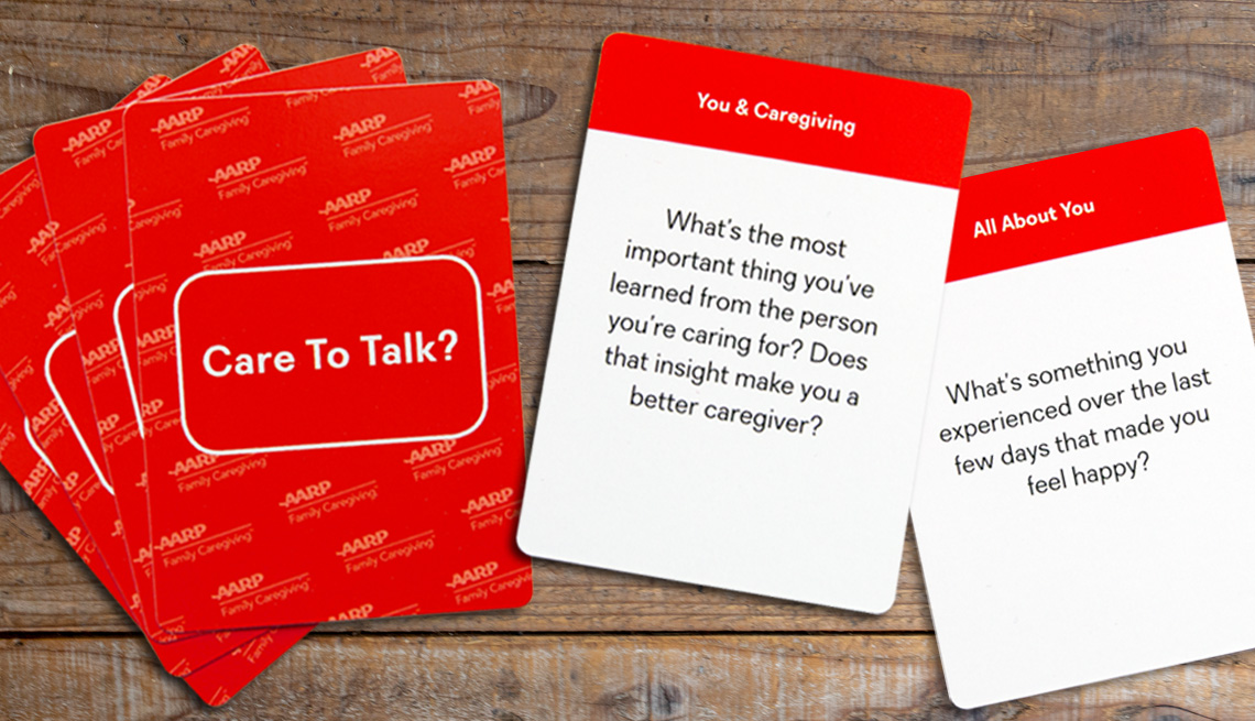 product photo of the red-backed care to talk cards showing the backs of four cards fanned out and the fronts of two cards with questions on them