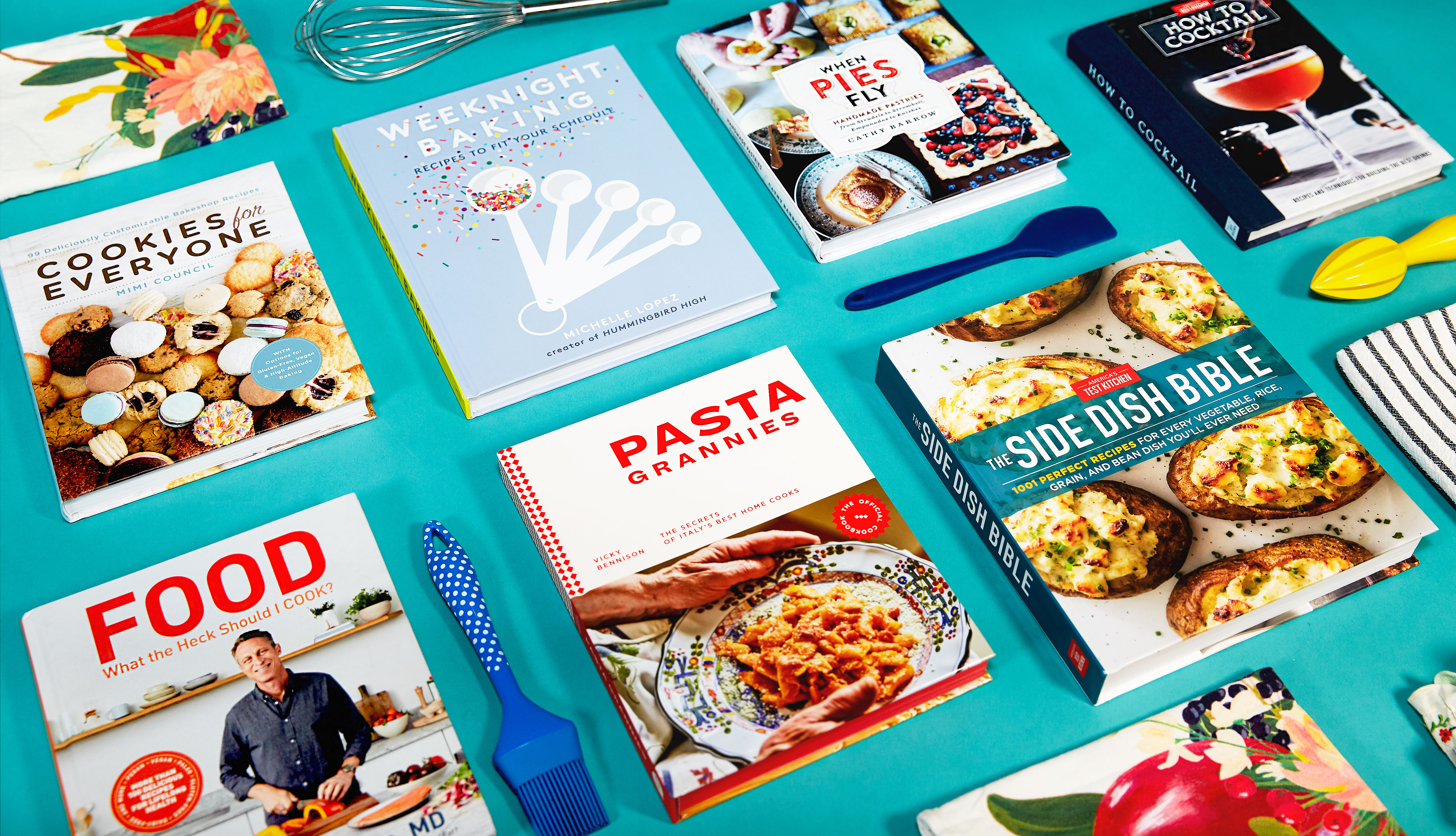 collage of cookbooks with utensils on a blue background