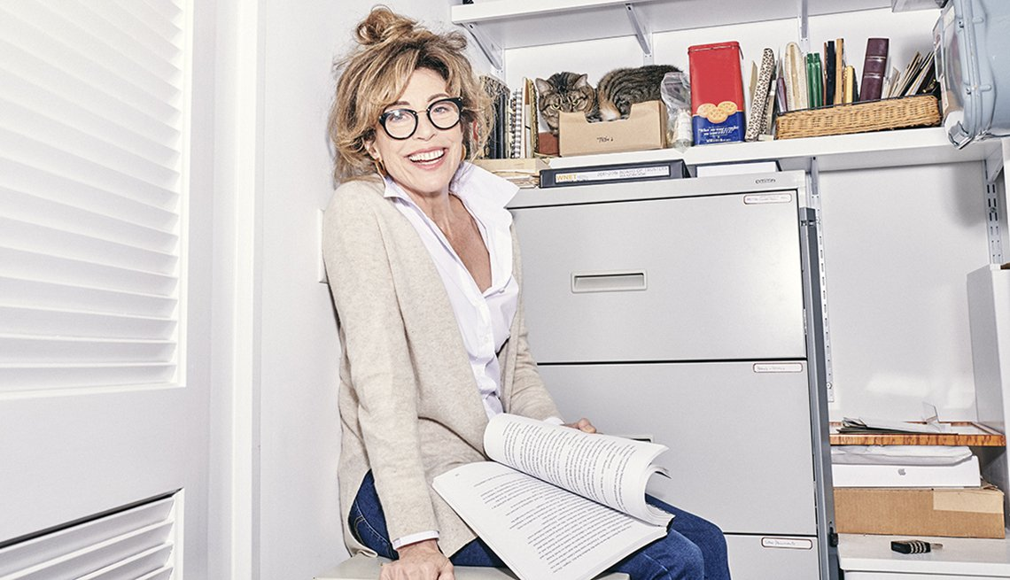 A women sitting next to a filing cabinet