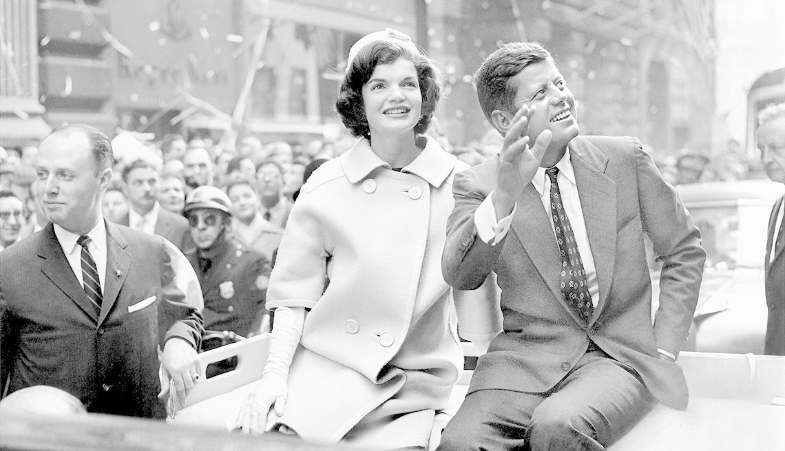 Democratic presidential nominee John F. Kennedy and his wife, Jacqueline, ride up Broadway in a ticker-tape parade
