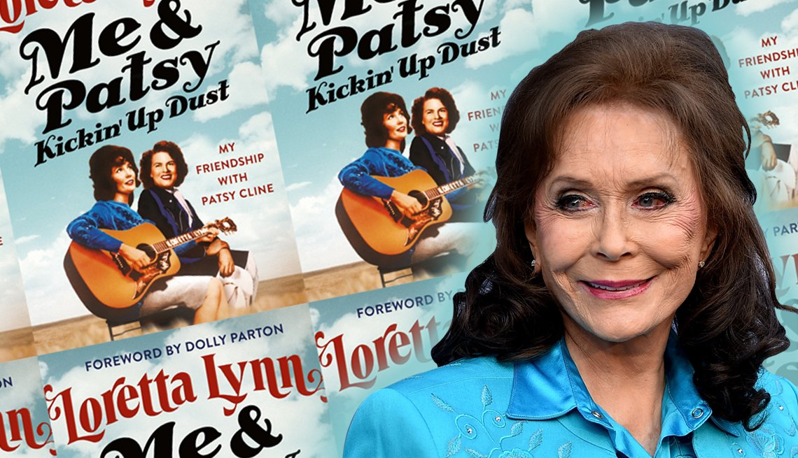 country music singer loretta lynn in front of an image of her new book cover