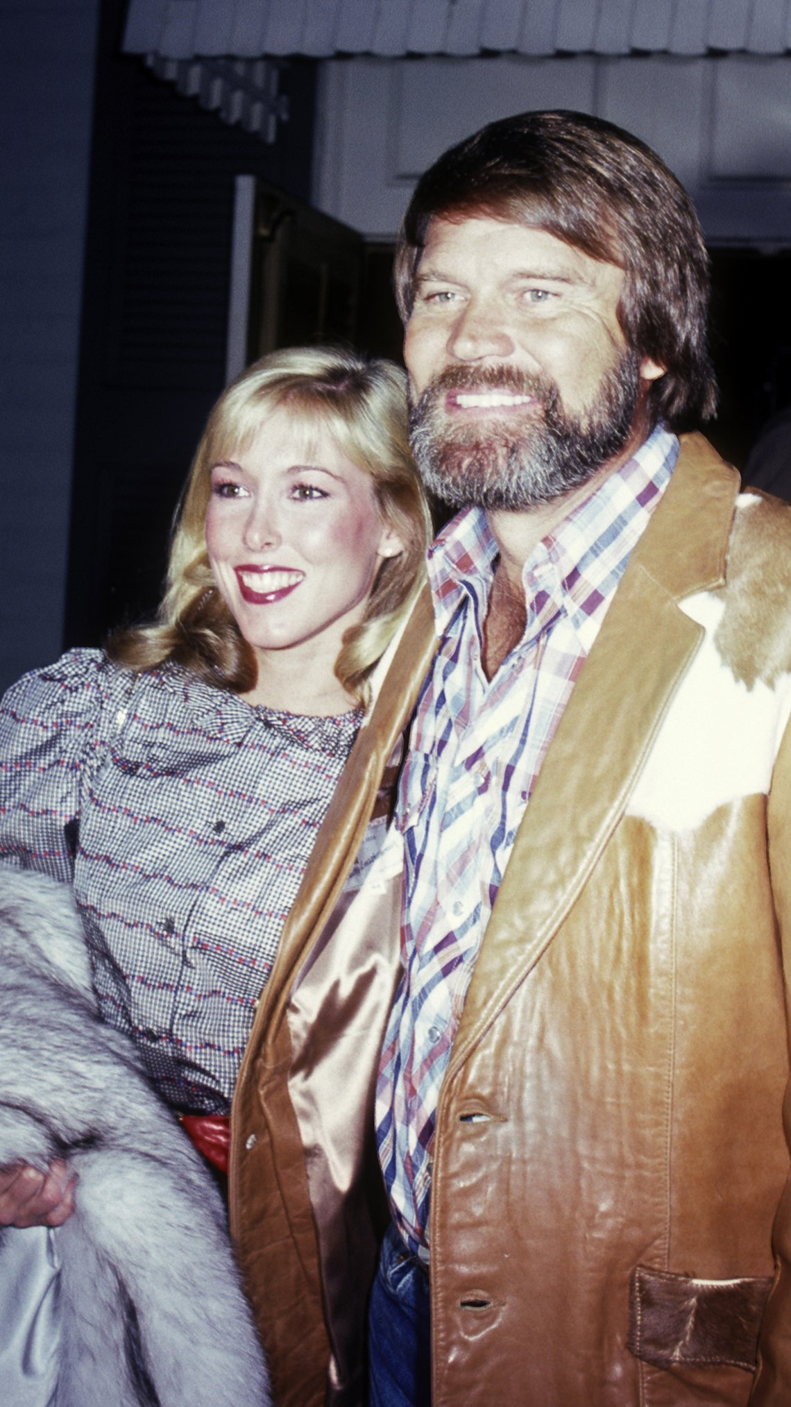 Glen Campbell and Kim Woollen attend Pierre Cossette Super Bowl Party in 1982