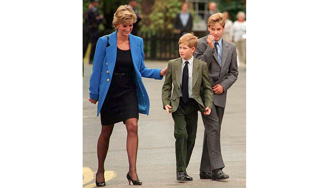 item 12 of Gallery image - Prince William with Diana, Princess of Wales and Prince Harry on the day he joined Eton in September 1995. at the Various in Various, United Kingdom.