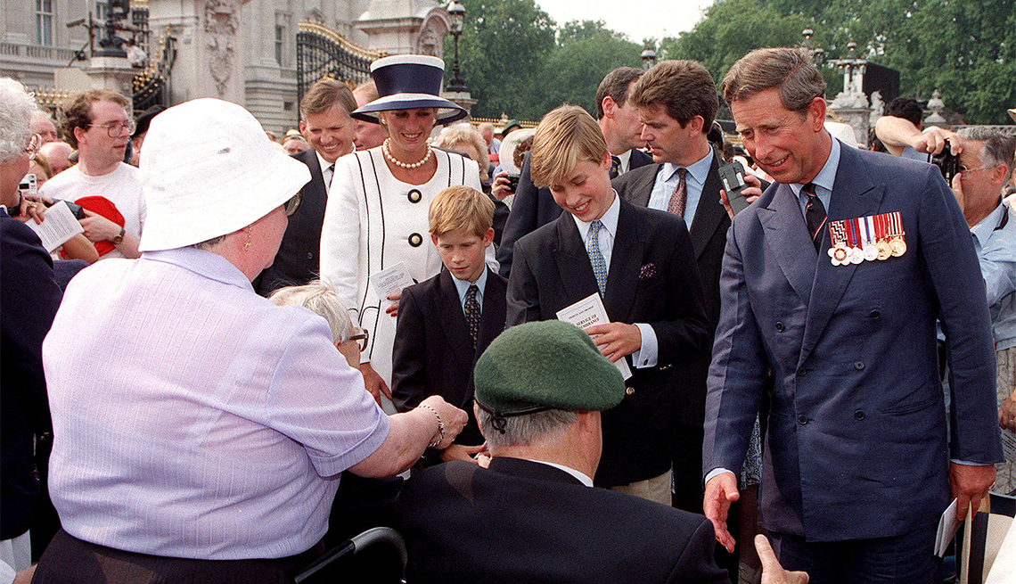 item 11 of Gallery image - Princess Diana, Prince Harry, Prince William and Prince Charles meeting old soldiers on a walkabout outside Buckingham Palace, London, during V.J. Day commemorations, August 1994.