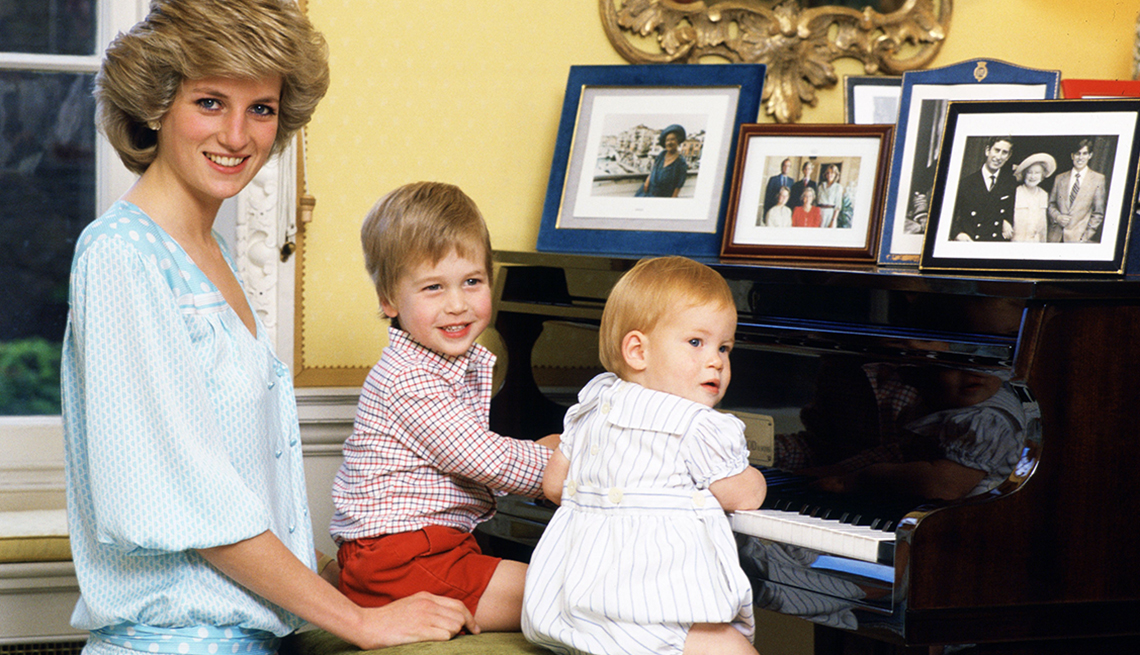 item 2 of Gallery image - Diana, Princess of Wales with her sons, Prince William and Prince Harry, at the piano in Kensington Palace.